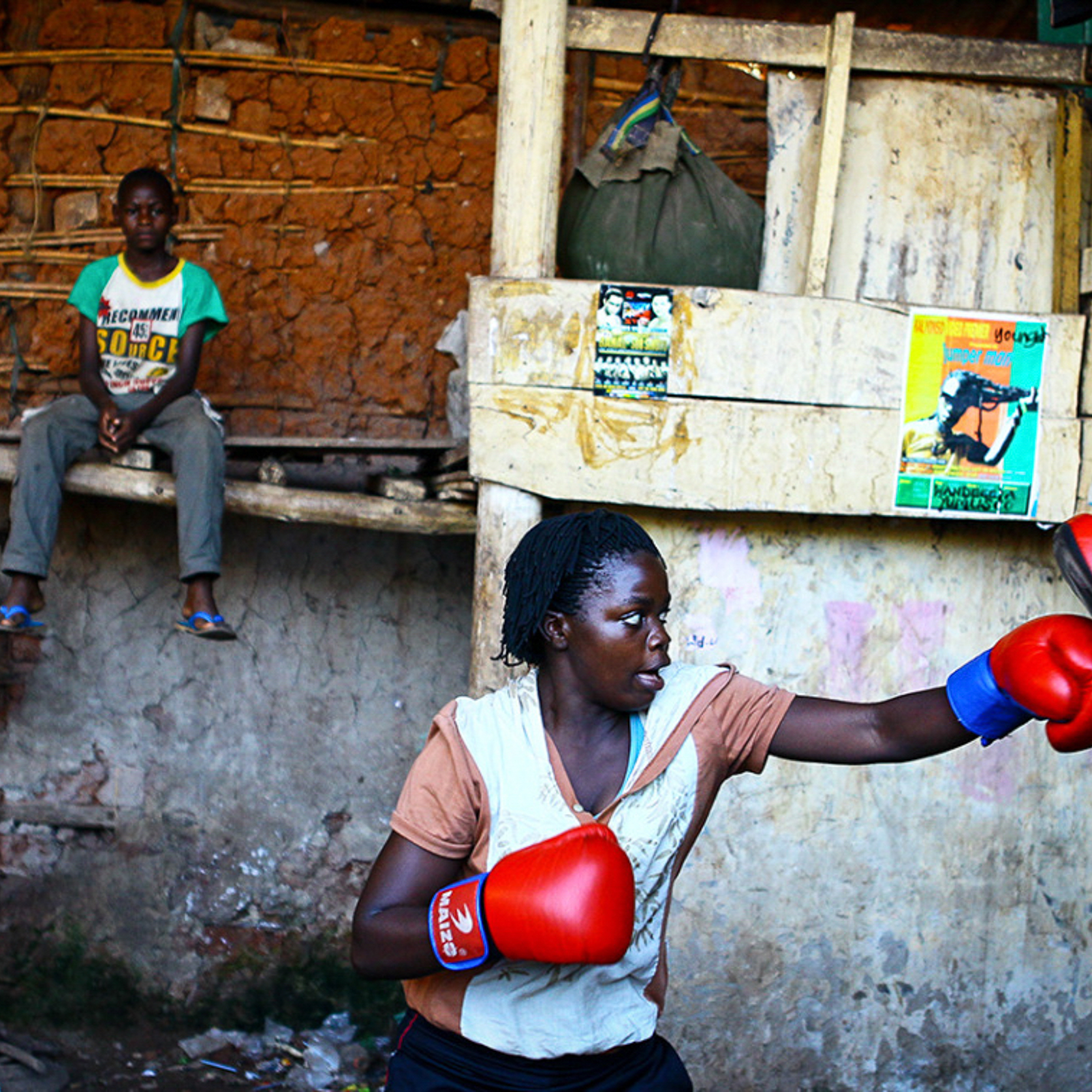 A female boxer trains inside a makeshift gym in Katanga, Kampala, Uganda. @edward_echwalu