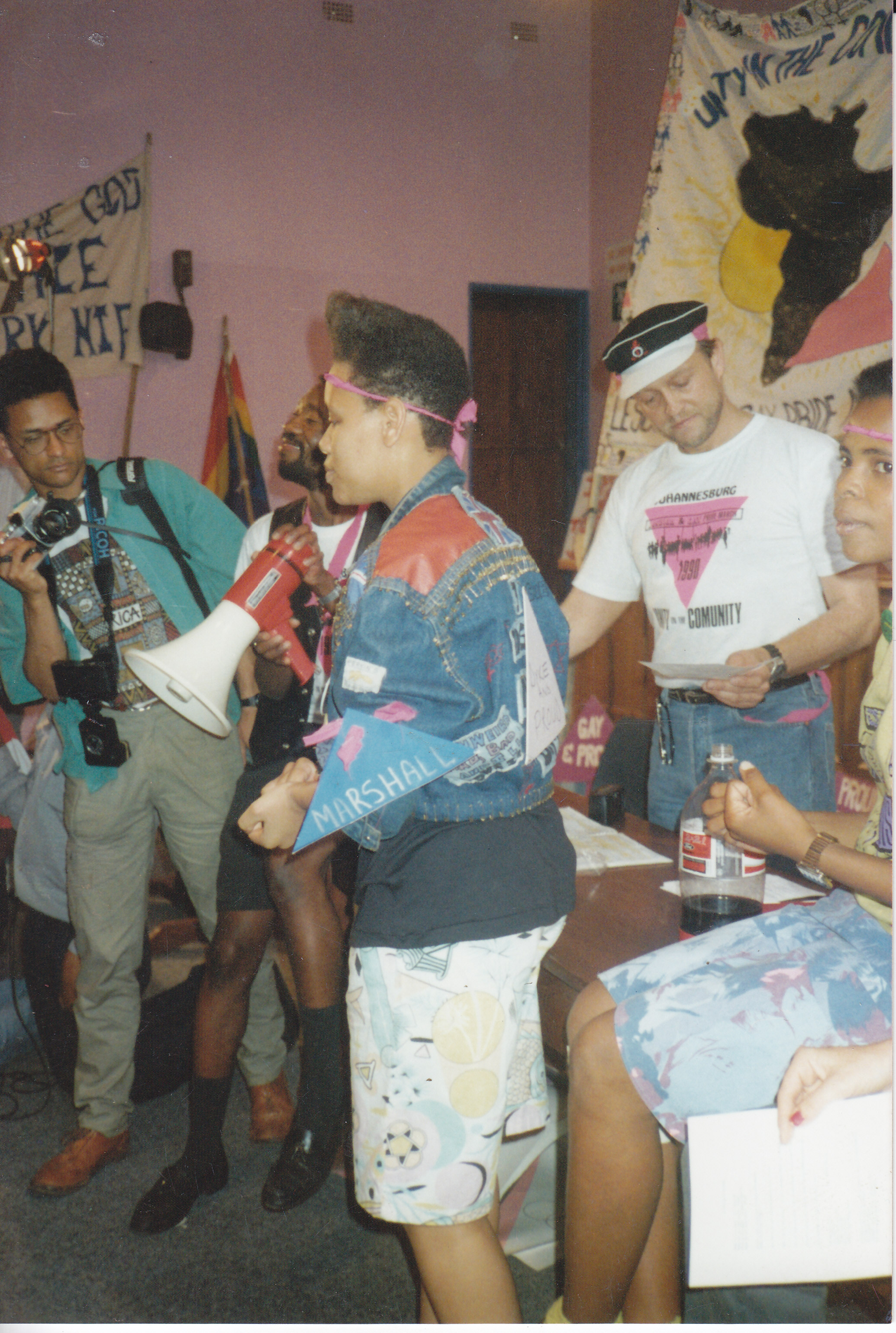 Beverley Ditsie speaks to the crowd before the first pride march in South Africa in Johannesburg in 1990. Photo Courtesy of Donné Rundle Collection/GALA Queer Archive/Johannesburg, South Africa