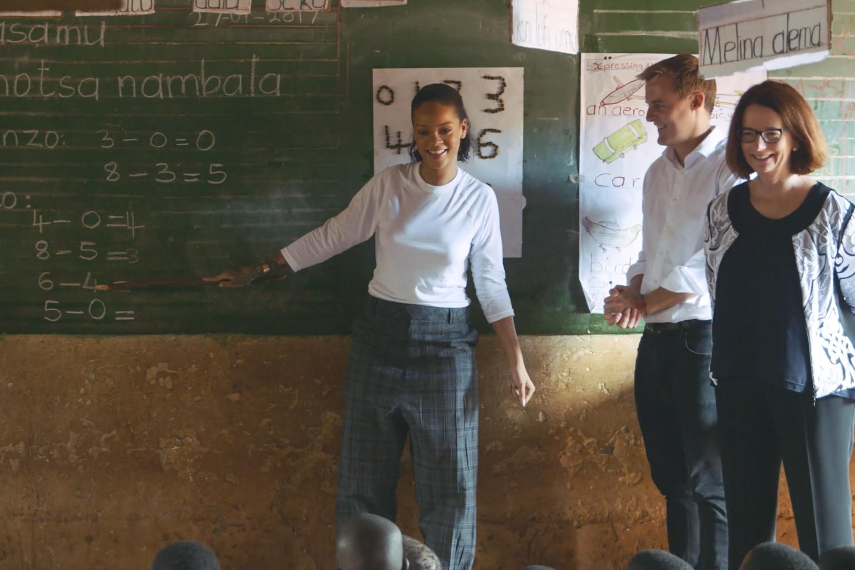 Rhianna, Hugh Evans, and Former Australian prime minister, Julia Gillard visit a Muzu School in Malawi