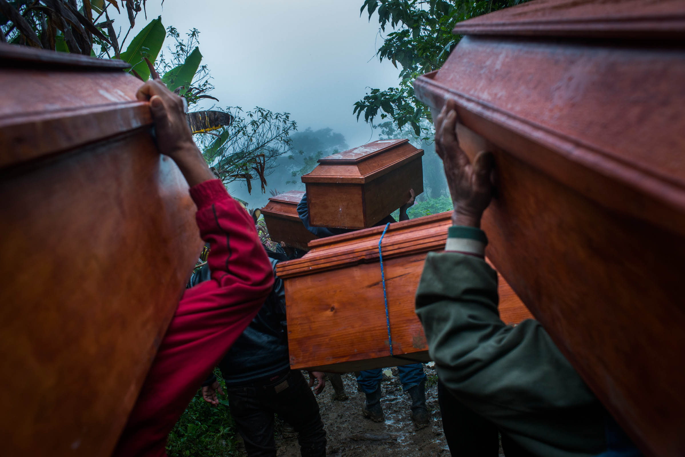 From the series: Chukel Caption: On the way to the cemetery to bury the 77 victims of the Covadonga massacre. Estrella Polar, Chajul. Guatemala © Photo Daniele Volpe / Native