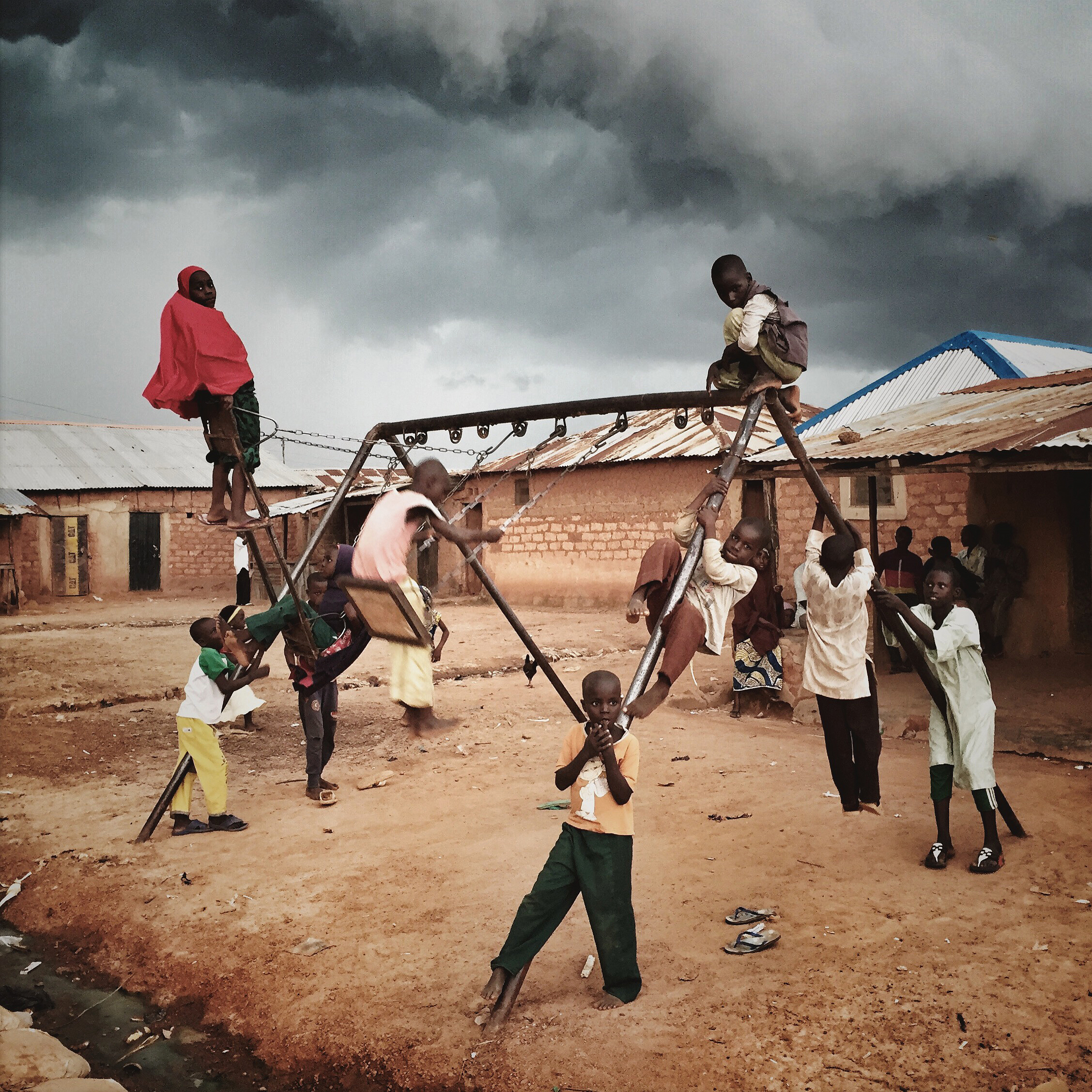 Children playing in a village near Zaria, Nigeria. @malinfezehai