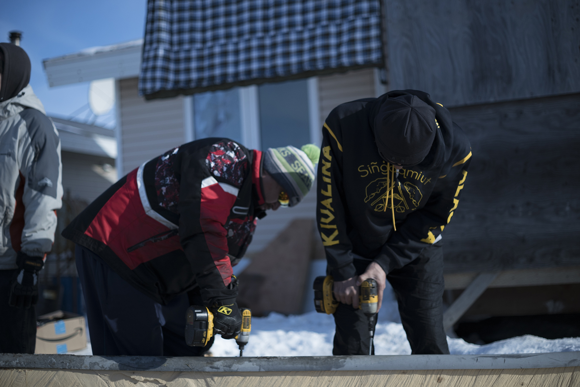 Kivalina residents working on whaling equipment. (Hans Glick/Global Citizen)
