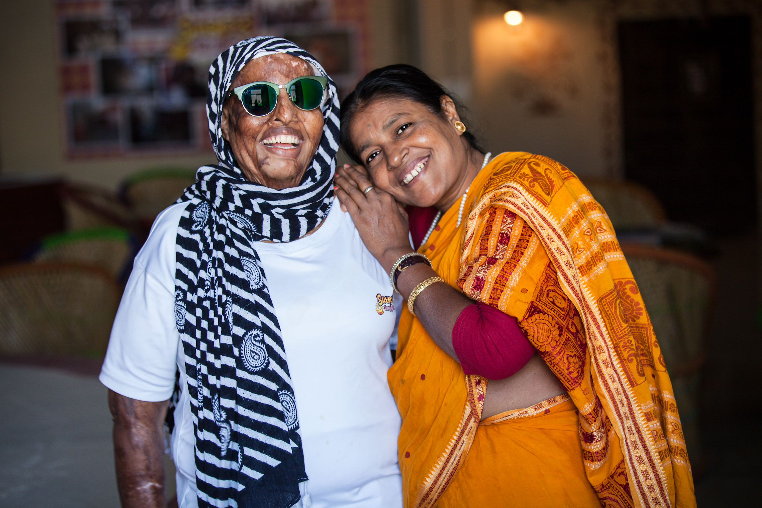 Rani (left), an acid attack survivor, pictured with her mother, Kavita, at Sheroes Cafe.