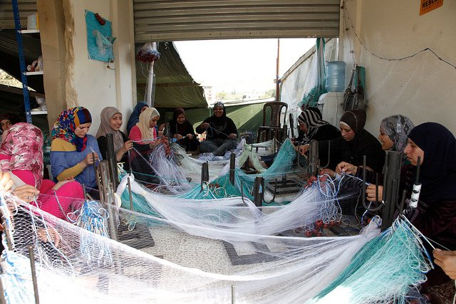 syrian women making fishing nets netting
