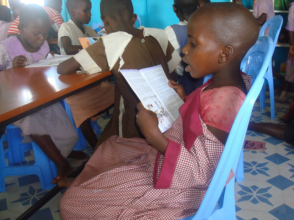 a young girls reading at the center.JPG