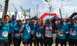 Article: The Inspiring Reason These 20 Friends Ran the Cape Town Marathon With Trees on Their Back