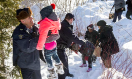 Article: Viral Photo Captures Refugees Fleeing the US for Canada on Foot