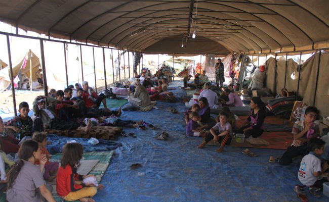 Iraqi_Yazidi_refugees_in_Newroz_camp_receive_help_from_International_Rescue_Committee edited.jpg