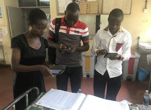 Fieldworkers extracting data from paper based hospital records (1).jpg