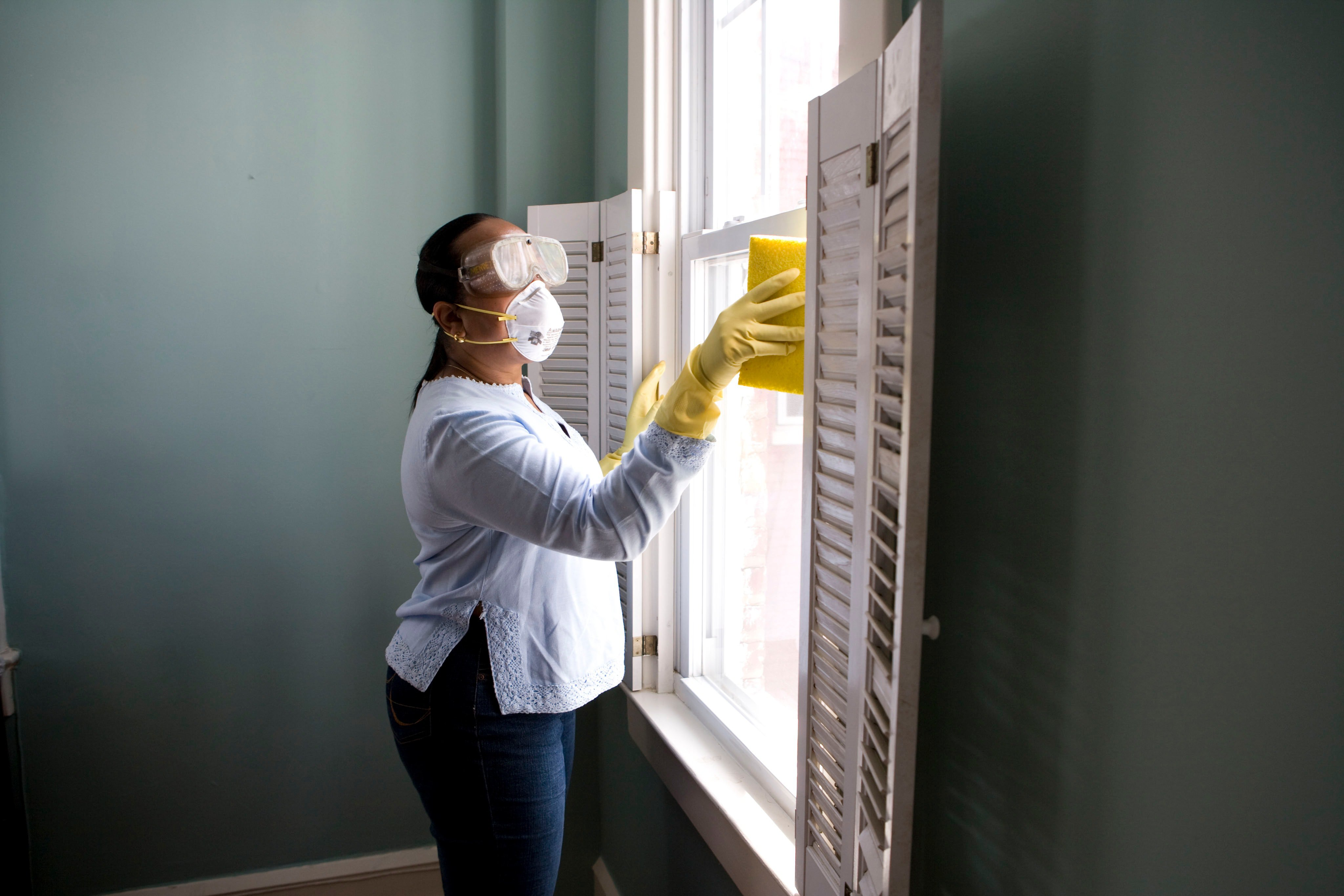Person dusting window