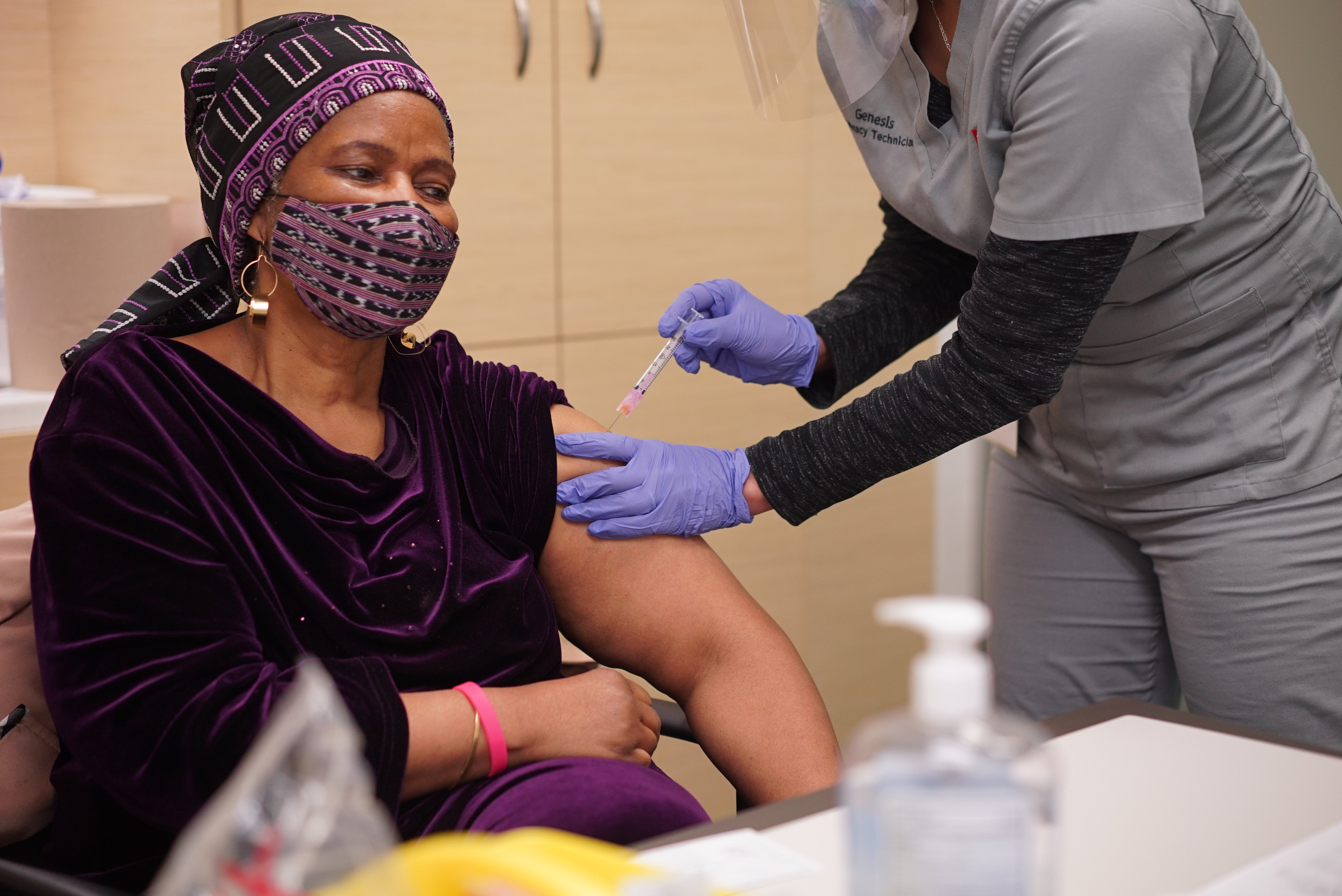 A nurse gives UN Women executive director, Phumzile Mlambo Ngcuka her first dose of the COVID-19 Vaccine.