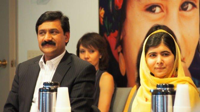 Malala and father.jpg