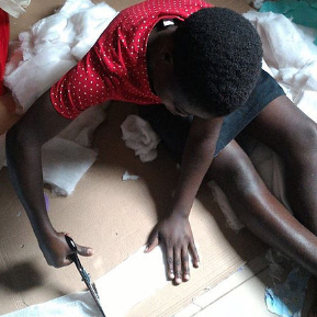 A woman from GUIU's Sewing Our Futures economic empowerment project making sanitary pads for the girls.png