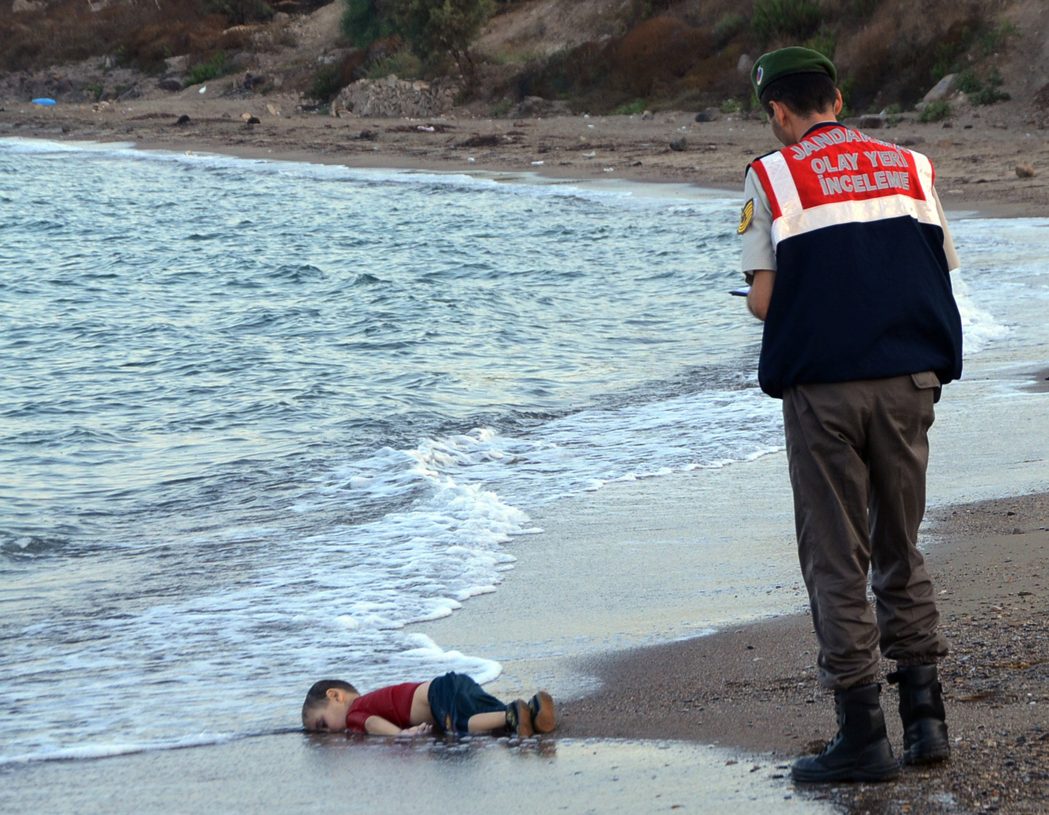 World-Photo-Day-Refugees-BODY-Aylan Kurdi dead on beach.jpg
