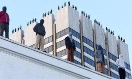 Article: The Powerful Reason Why 84 Male Statues Are Standing on This London Rooftop