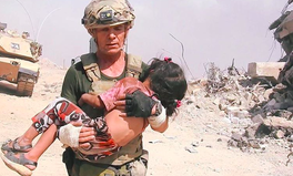 Article: Man Runs Through Gunfire to Save Little Girl in Iraq