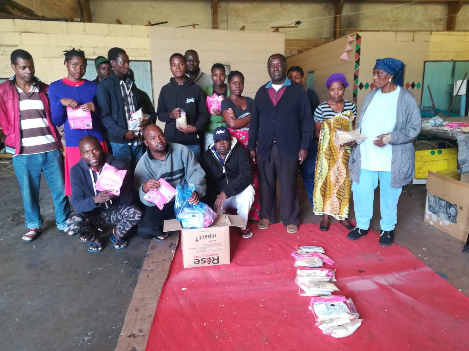 Refugees receiving food parcels.jpg