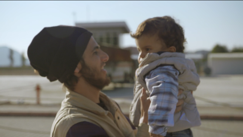 A White Helmet with a rescued child.