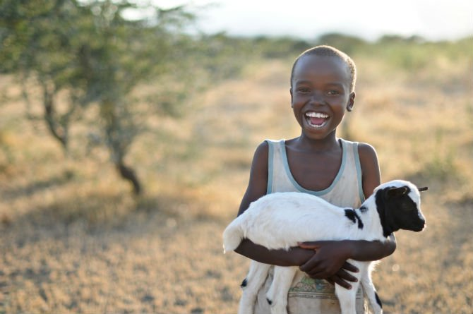 Kid with goat world vision gift.jpg