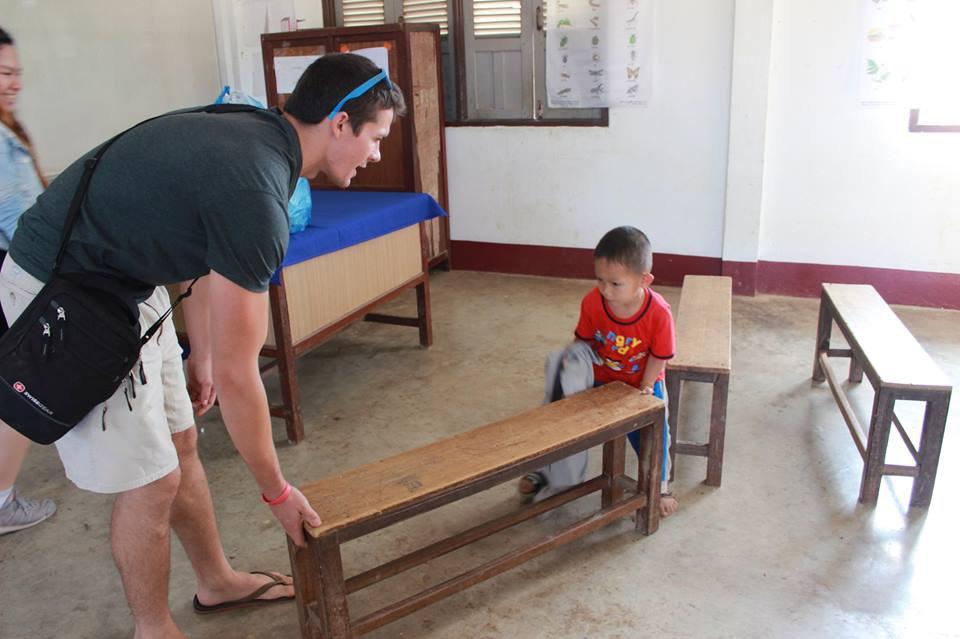 Brendan Walsh in Laos classroom