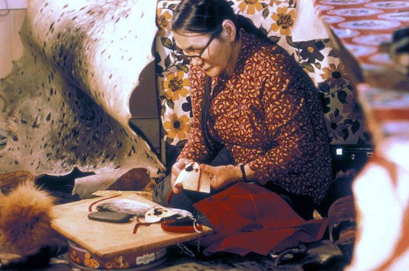 1024px-Native_Alaskan_woman_making_moccassins_hand_made.jpg