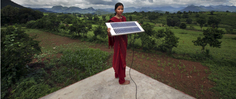 Indian girl holding solar panel.jpg