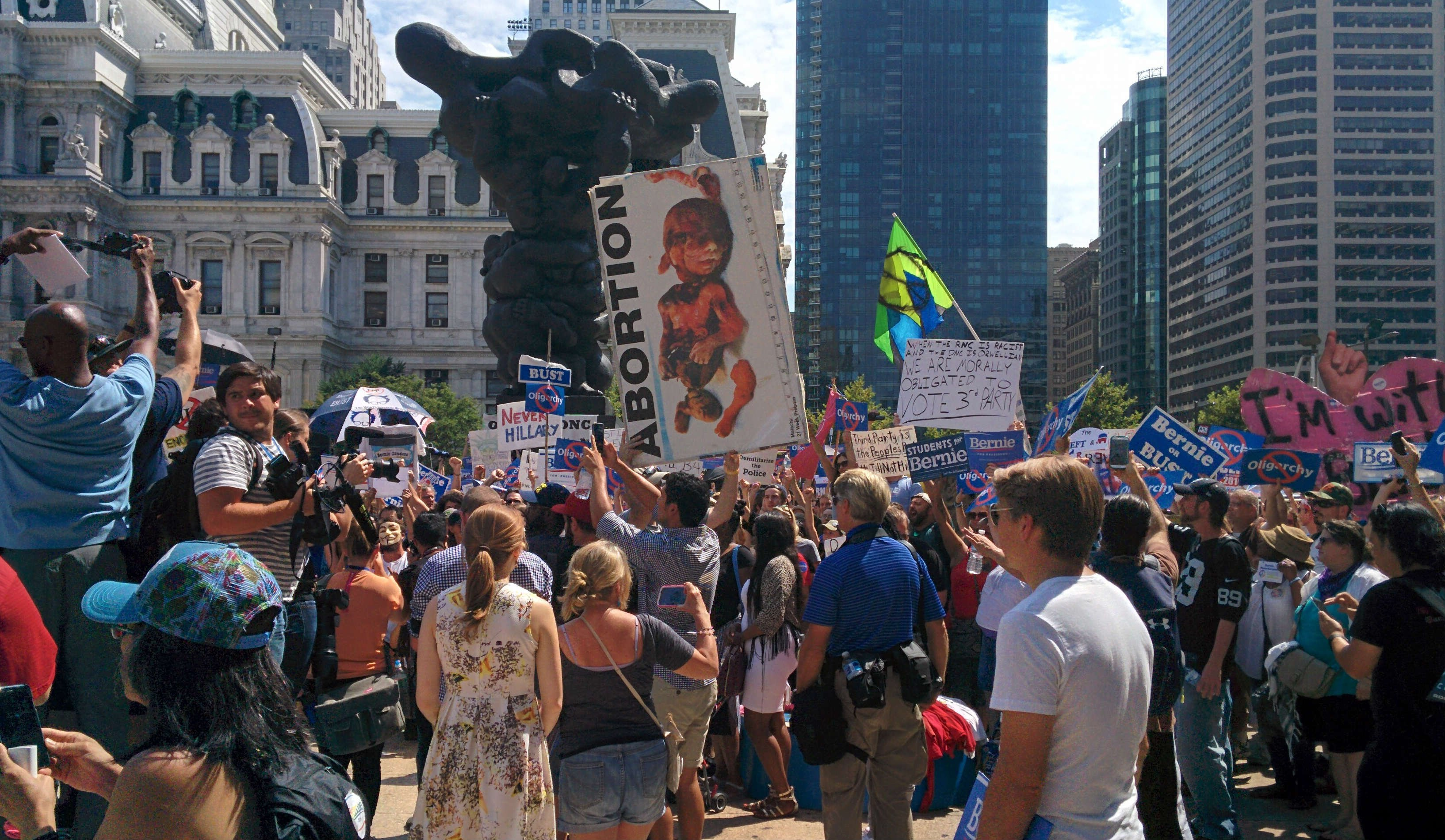 DNC-Protestors-Show-up-views-BODY-Abortion Poster in crowd.jpg