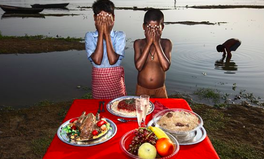 Article: Photo of 'Poor' Indian Boys With Fake Food Sparks Debate Over 'Poverty Porn'