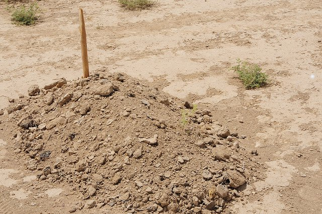 unmarked grave sand dirt