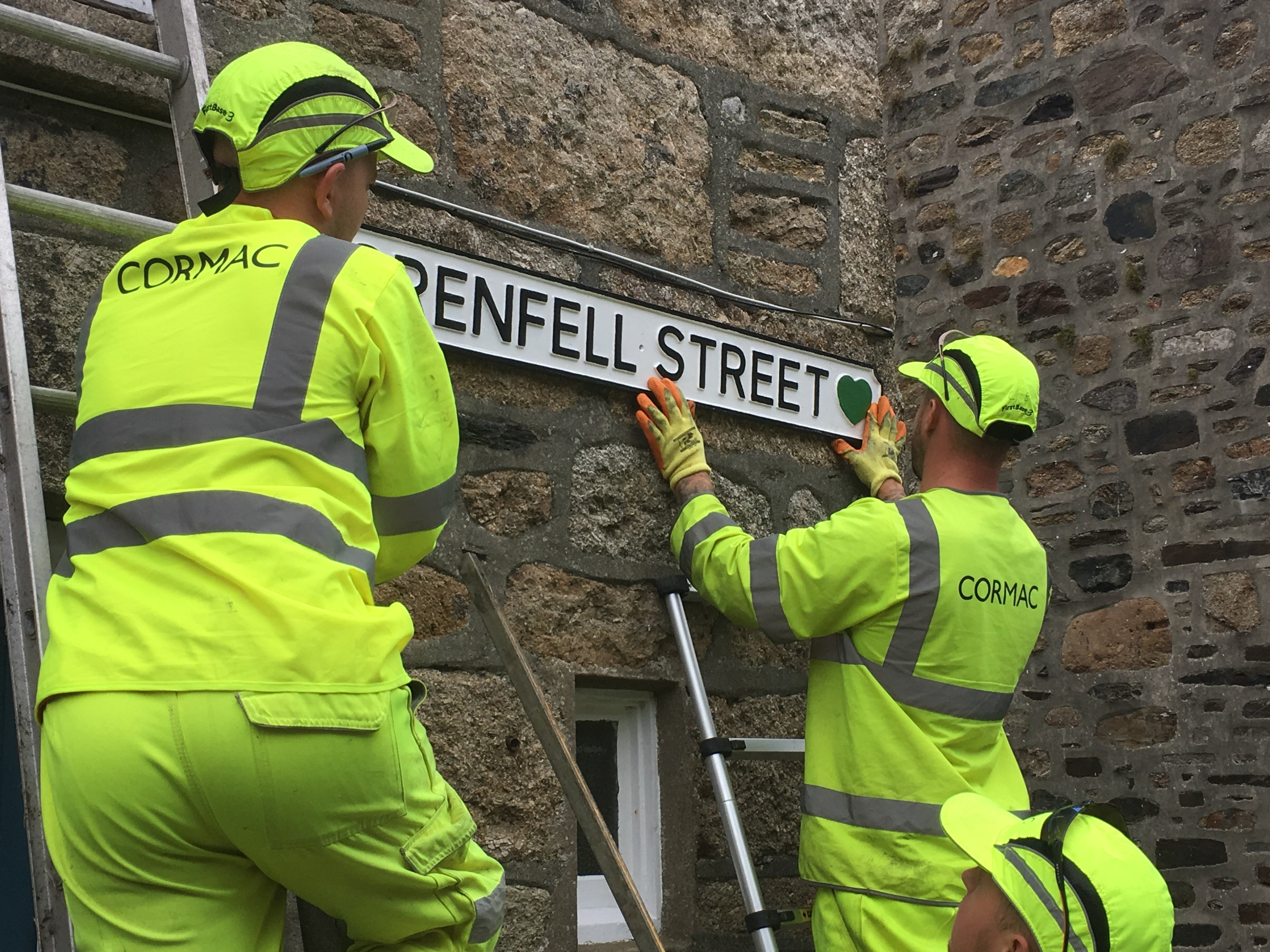 Cormac errects first UK Grenfell Street Sign in Mousehole - photo Cornwall Hugs Grenfell.JPG