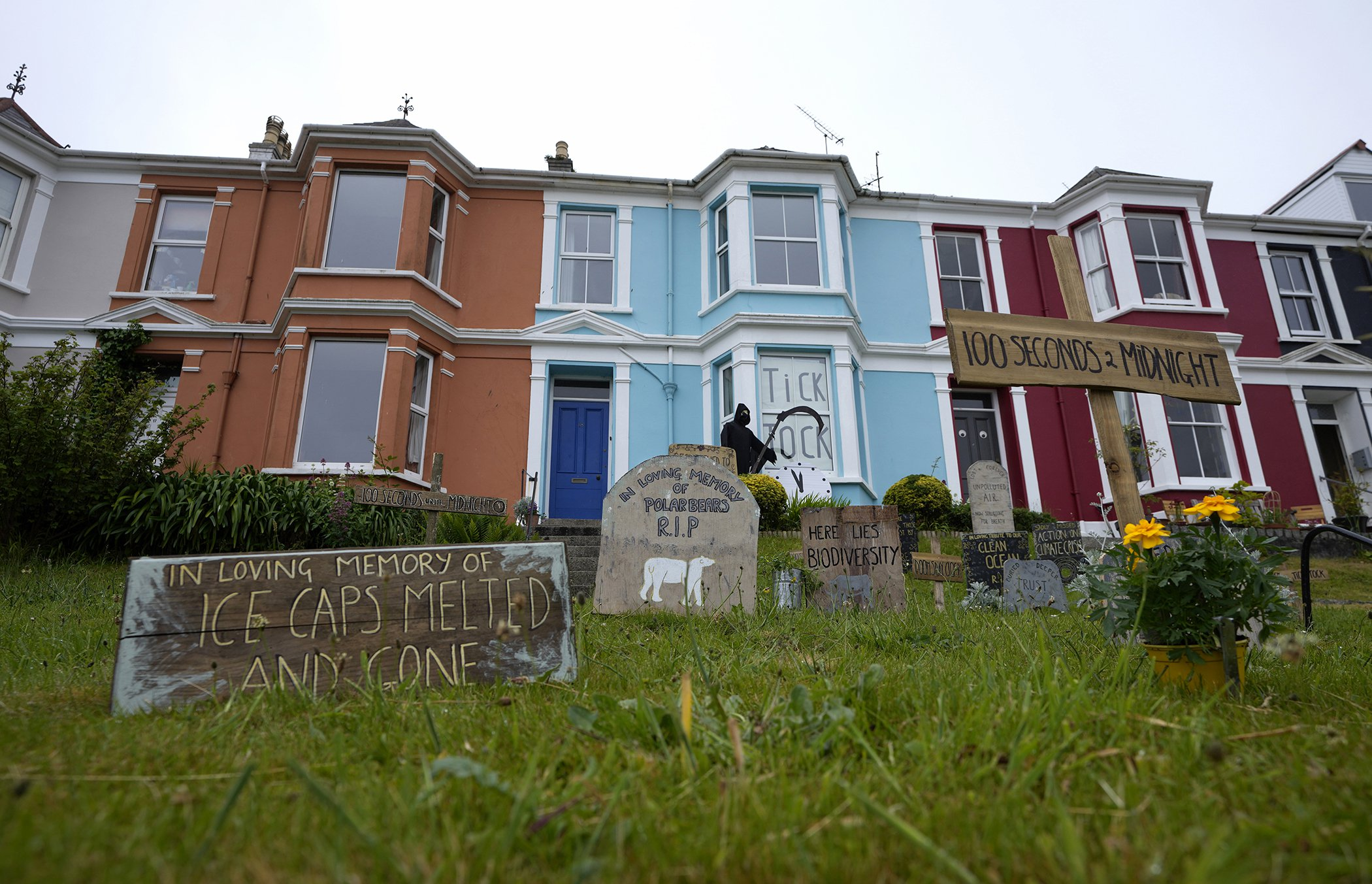 G7-Cornwall-Climate-Protests-Signs-Homes.jpg