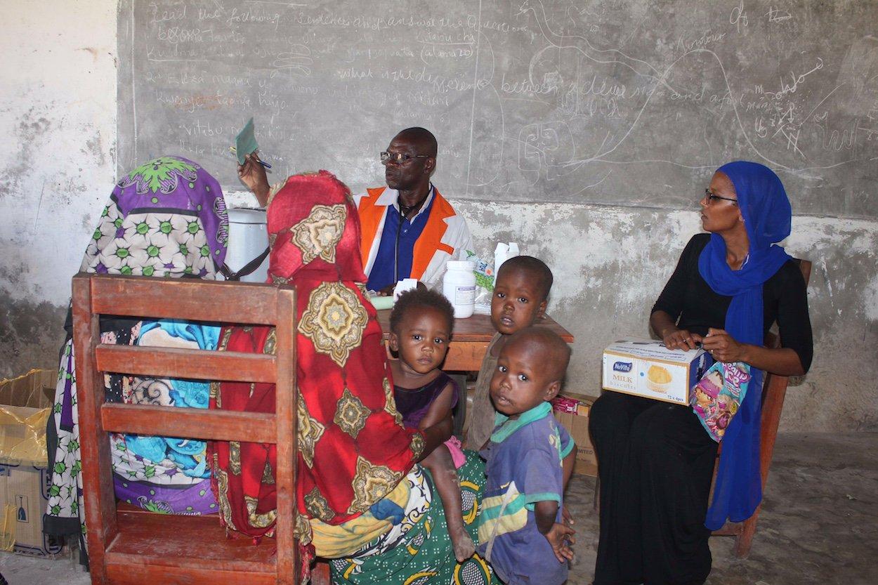 Nurse Kalu and Umra at the immunization table.jpg