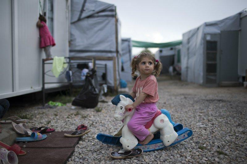 AP_17169547123240_Syria_Refugee_Greece_Petros Giannakouris.jpg