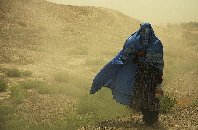 afghan woman sand