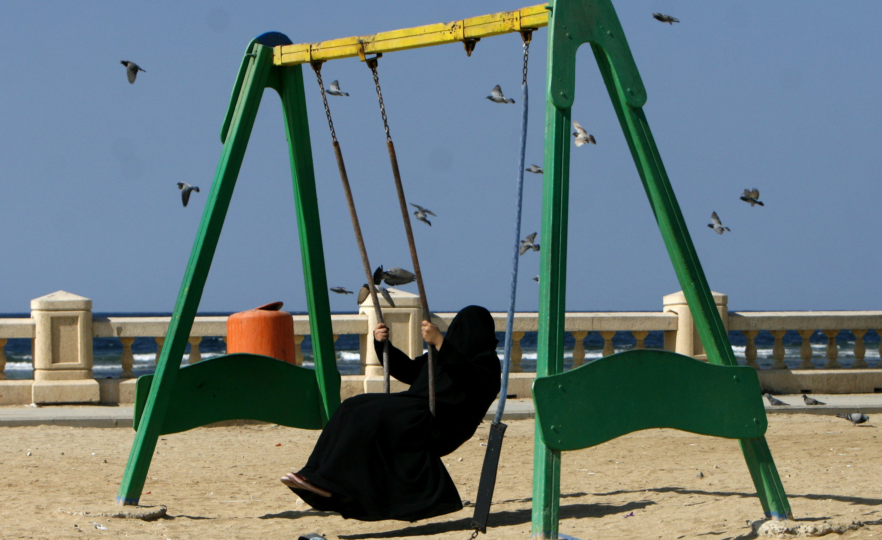Saudi Arabia woman on swing