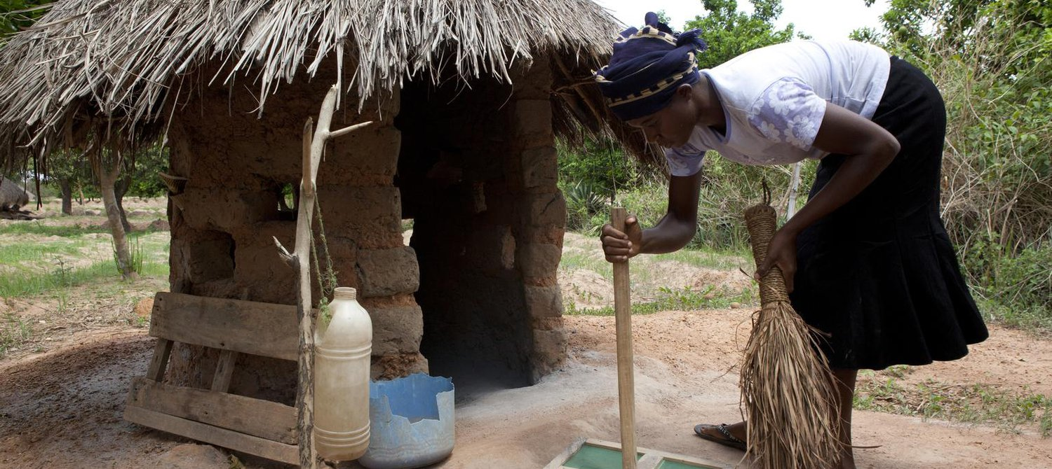 Image result for A woman cleans a ventilated drop-hole cover on her latrine, in the community of Iorpuu, Nigeria in April 2013.