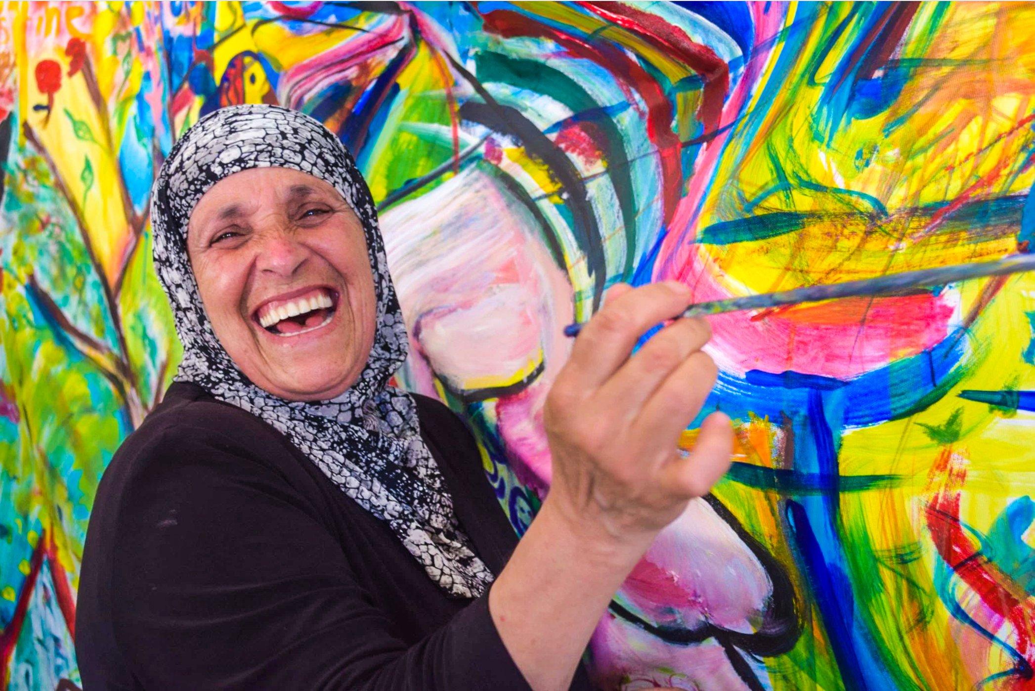 Palestinian Woman Painting Laughing.jpg